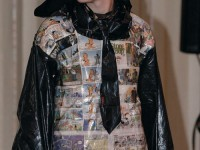 Matthew Bolaños shows off his garbage bag tie and newspaper jacket at the Eco-Friendly Fashion Show on Friday in the Hughes-Trigg Varisty.