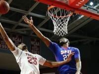 Temple's Devontae Watson and SMU's Jordan Tolbert battle for a rebound in Sunday's game in Philadelphia Photo credit: AP Photo/Matt Slocum