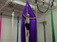 Founder Fanny Kerwich climbs to the top of a silk. Photo credit: Jacquelyn Elias