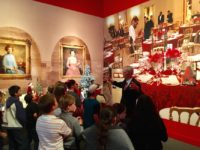 A docent at the George W. Bush Presidential Library and Museum guides a visiting elementary  class through the new Christmas exhibit. Photo credit: Klara Bradshaw