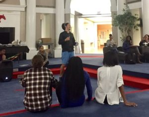 SMU Theatre student Curtis Faulkner performs for the crowd gathered at the Atrium. Photo credit: Lili Johnston