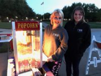 Mollie Mayfield (left) and Amanda Taft (right) posing by the popcorn station at the Gamma Phi Beta Under the Crescent Moon movie night. Photo credit: Cynthia Mclaughlin