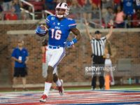 SMU wide receiver Courtland Sutton runs in one of his four touchdowns. Photo credit: Getty Images
