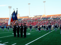Several SMU band members kneel while playing the National Anthem in 2016. Photo credit: Mollie Mayfield