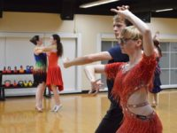 Dillon Weir and Destiny Rose Murphy dance the samba. Photo credit: Harriette Hauske