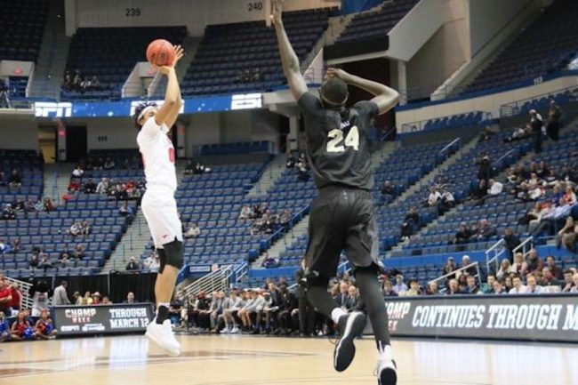 Ben Moore over Tacko Fall AAC embed.jpg