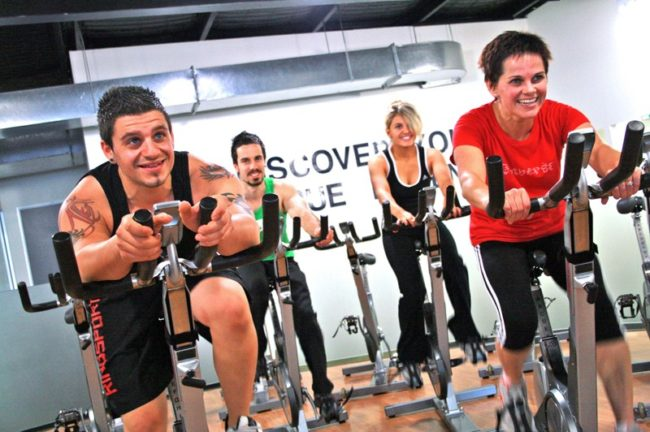 Spin_Cycle_Indoor_Cycling_Class_at_a_Gym.jpg