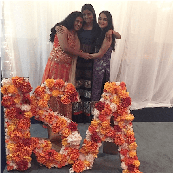 Pooja with Sarah Subramanian and Siddhakshi Solanki at the 2017 Indian Student Association's Diwali function, during her sophomore year.