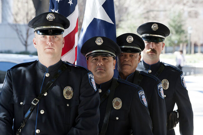 Police Officers at a bench dedication to fallen SMU police officer Mark McCullers