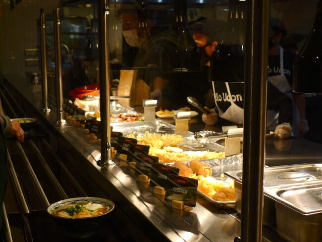 Marugame diners choose from a selection of Japanese street foods after receiving their udon.