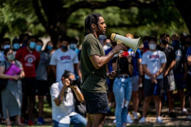 Kazadi speaks at protest. Courtesy of Kazadi.