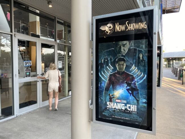 A Shang-Chi movie poster in front of the Angelika box-office in Dallas.
